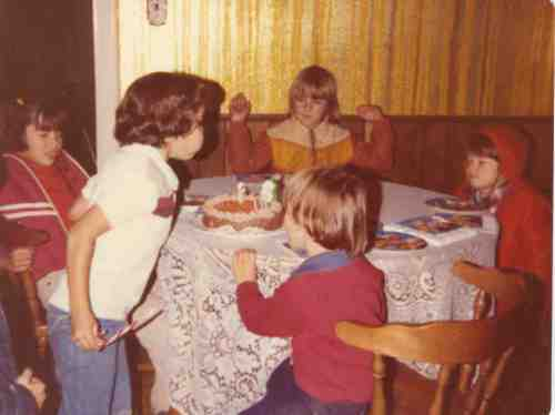 My 6th birthday, Dec. 1980. Left to right: Susie, me, Isaac, Mikey. (Back to the camera was my cousin Ryan). My hair was never straight enough for a perfect 1980 bowl-cut.