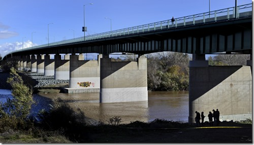 Chris Kaufman/Appeal-Democrat Yuba City Police officers and Sutter County Sheriff's deputies investigate the scene where a body was discovered Sunday, December 2, 2012 under the 10th Street Bridge in Yuba City.